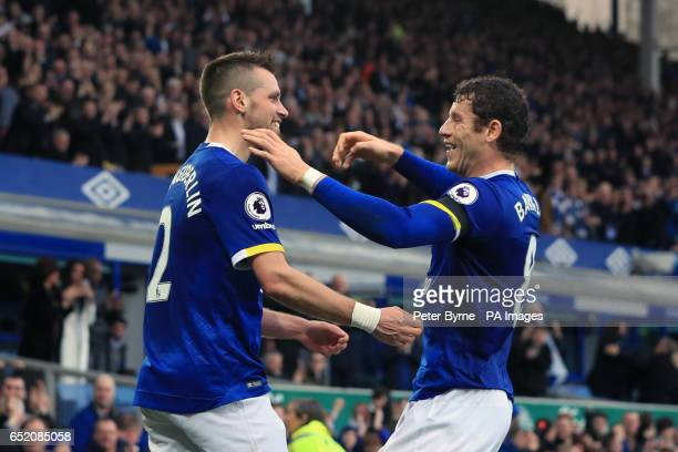 Everton's Morgan Schneiderlin celebrates scoring his side's second goal of the game with Ross Barkley during the Premier League match at Goodison...