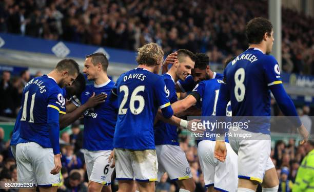 Everton's Morgan Schneiderlin celebrates scoring his side's second goal of the game with teammates during the Premier League match at Goodison Park...