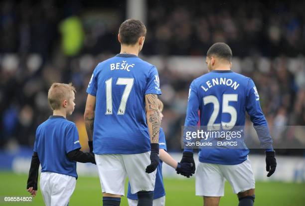 Everton's Muhamed Besic and Aaron Lennon walk out onto the pitch with mascots before kickoff