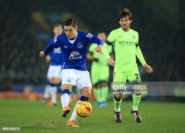 Everton's Muhamed Besic in action with Manchester City's David Silva