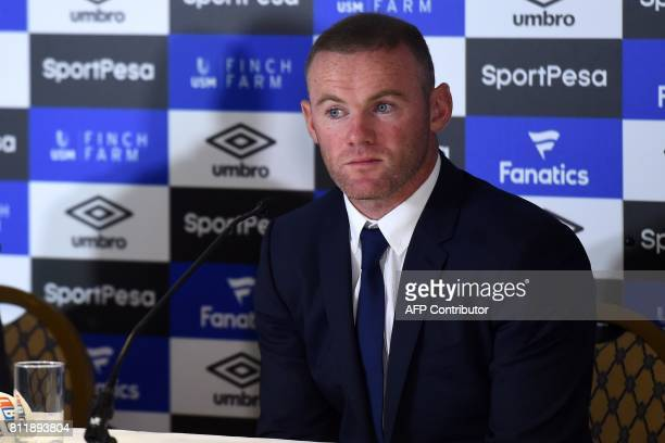 Everton's new signing English striker Wayne Rooney attends a press conference at Goodison Park in Liverpool on July 10 following his move to Everton...