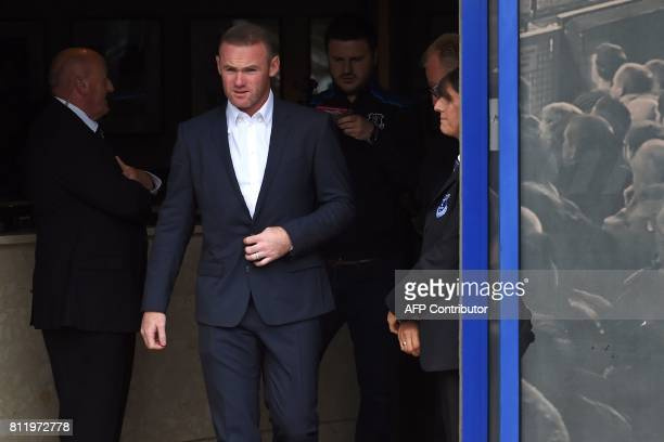 Everton's new signing English striker Wayne Rooney comes out to meet supporters after giving a press conference at Goodison Park in Liverpool on July...