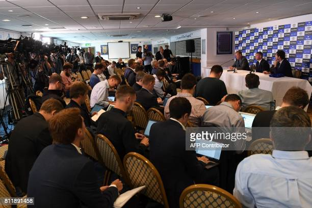 Everton's new signing English striker Wayne Rooney speaks during a press conference at Goodison Park in Liverpool on July 10 following his move to...