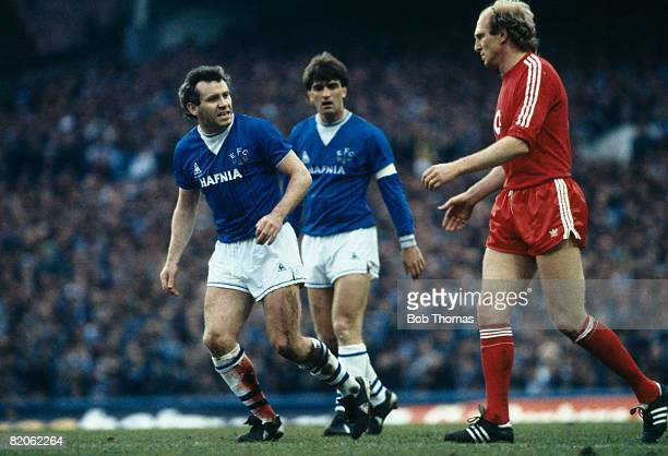 Everton's Peter Reid with his badly gashed leg bleeding through his sock looks angrily towards Bayern Munich's Dieter Hoeness during their European...
