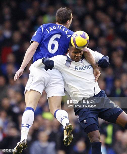 Everton's Phil Jagielka and Bolton Wanderers' Ariza Makukula battle for the ball