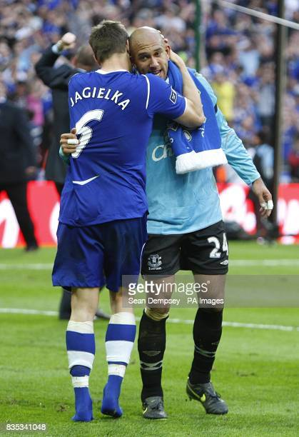 Everton's Phil Jagielka and goalkeeper Tim Howard celebrate after the final whistle
