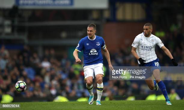 Everton's Phil Jagielka and Leicester City's Islam Slimani battle for the ball during the Premier League match at Goodison Park Liverpool