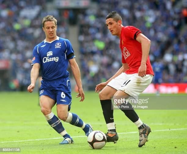 Everton's Phil Jagielka and Manchester United's Federico Macheda battle for the ball