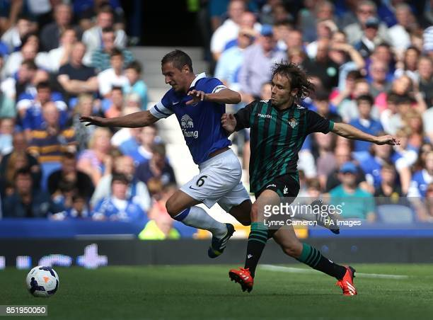 Everton's Phil Jagielka and Real Betis' Joan Verdu battle for the ball