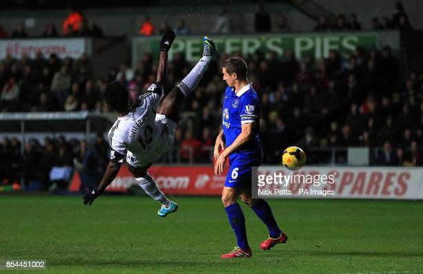 Everton's Phil Jagielka and Swansea City's Wilfried Bony battle for the ball