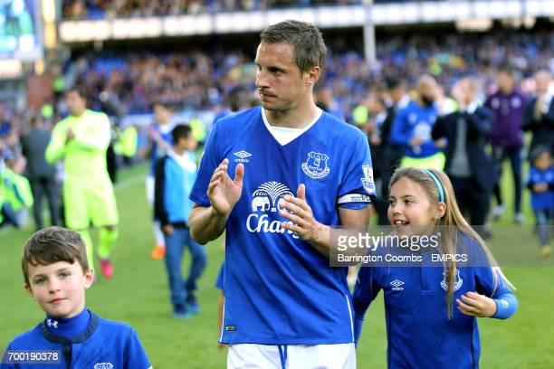 Everton's Phil Jagielka applauds the crowd during the lap of appreciation
