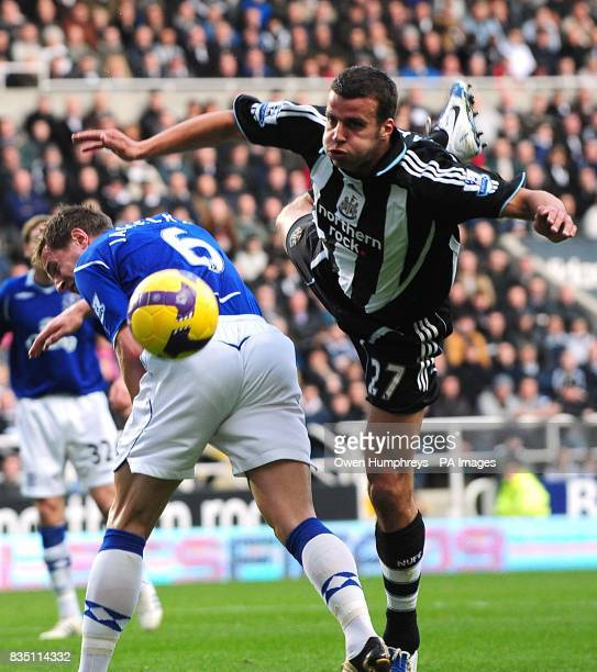 Everton's Phil Jagielka battle for the ball with and Newcastle United's Steven Taylor battle for the ball
