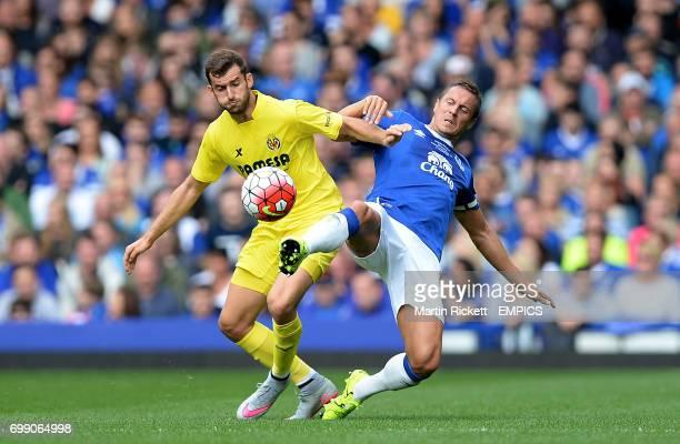 Everton's Phil Jagielka battles for the ball with Villarreal's Leo Baptistao