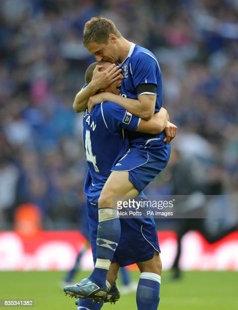 Everton's Phil Jagielka celebrates scoring the winning penalty in the shootout with teammate James Vaughan