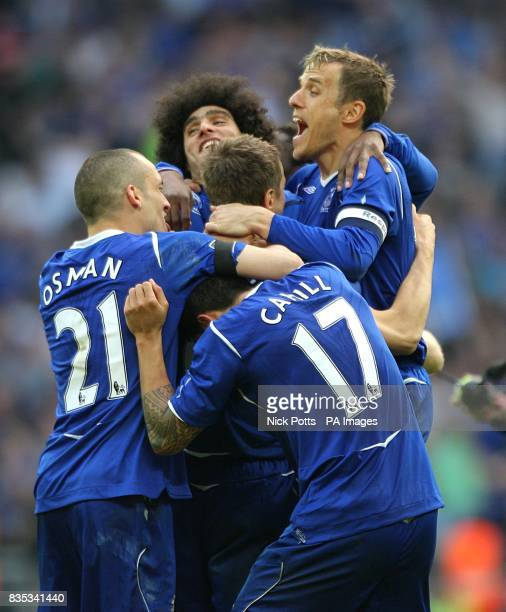 Everton's Phil Jagielka celebrates scoring the winning penalty in the shootout with teammates