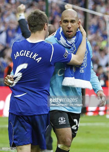 Everton's Phil Jagielka celebrates with team mate Tim Howard after the final whistle