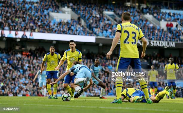 Everton's Phil Jagielka fouls Manchester City's David Silva for the penalty