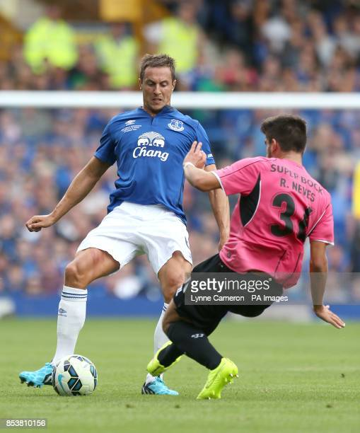 Everton's Phil Jagielka in action with FC Porto's Ruben Neves