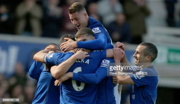 Everton's Phil Jagielka is congratulated by team mates