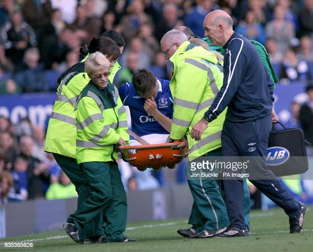 Everton's Phil Jagielka is stretchered from the pitch