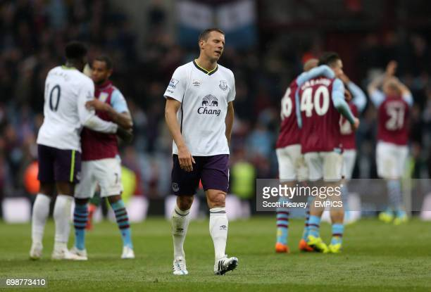 Everton's Phil Jagielka looks dejected after their defeat