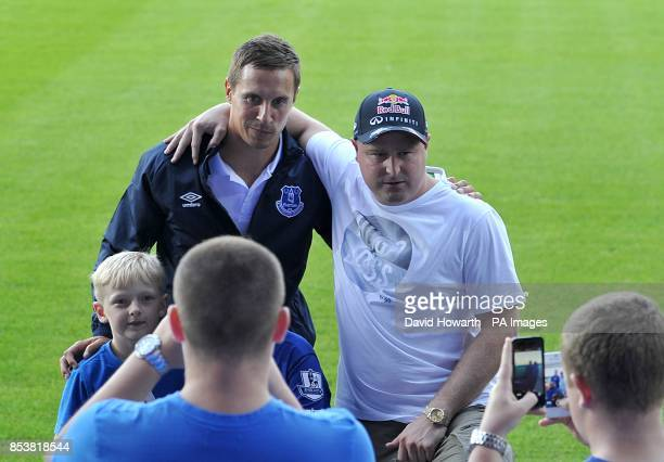 Everton's Phil Jagielka poses for a photograph with fans before kickoff