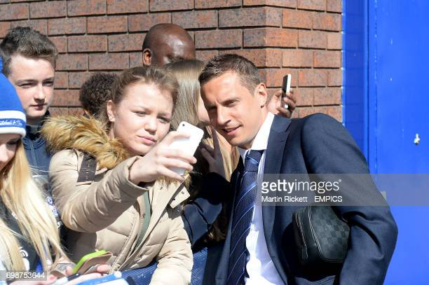 Everton's Phil Jagielka poses for a photograph with fans outside Goodison Park