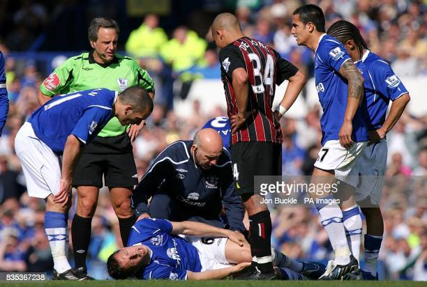 Everton's Phil Jagielka receives treatment for an injury