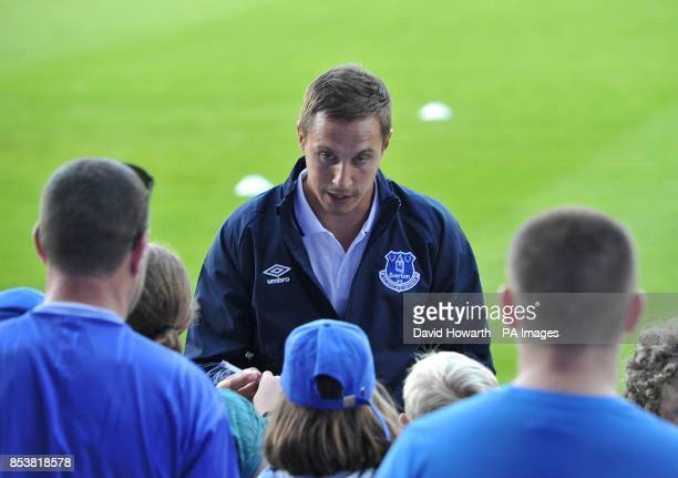 Everton's Phil Jagielka signs autographs for fans before kickoff