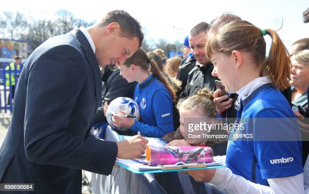 Everton's Phil Jagielka signs autographs for fans before the match against Southampton