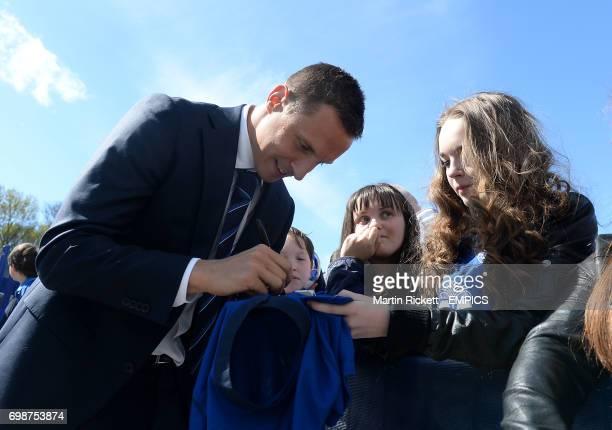 Everton's Phil Jagielka signs autographs for fans outside Goodison Park