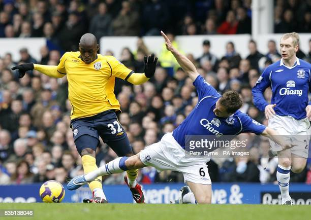 Everton's Phil Jagielka stretches to battle for the ball with West Bromwich Albion's MarcAntoine Fortune