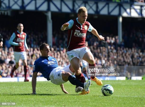 Everton's Phil Jagielka tackles Burnley's Scott Arfield