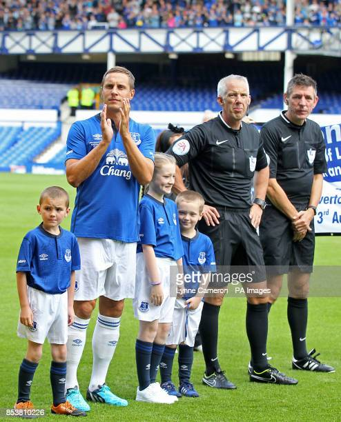 Everton's Phil Jagielka with mascots before the game