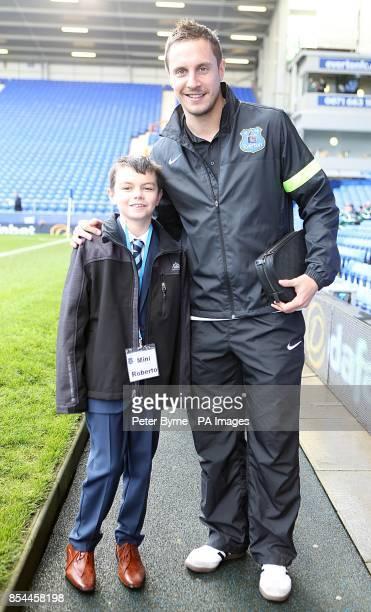 Everton's Phil Jagielka with mini Roberto Martinez