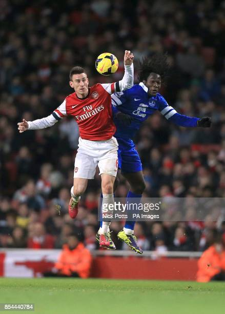 Everton's Romelu Lukaku and Arsenal's Laurent Koscielny battle for the ball in the air
