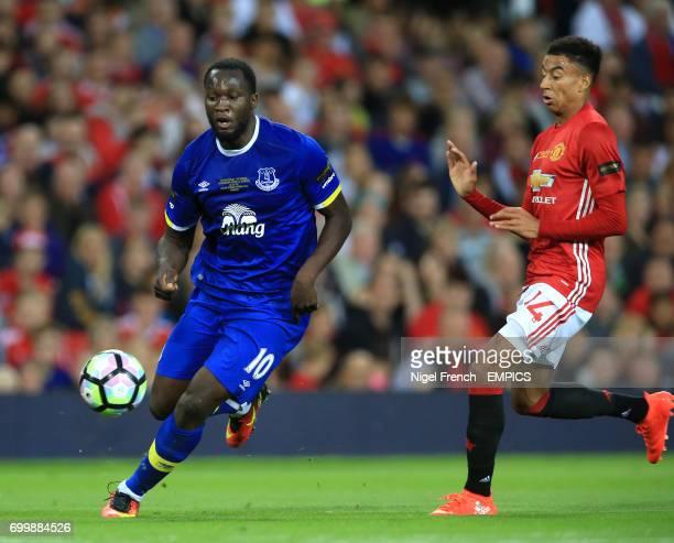 Everton's Romelu Lukaku and Manchester United's Jesse Lingard battle for the ball