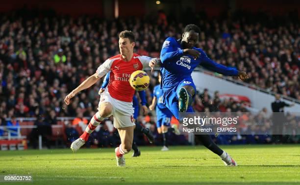 Everton's Romelu Lukaku has a shot on goal under pressure from Arsenal's Laurent Koscielny