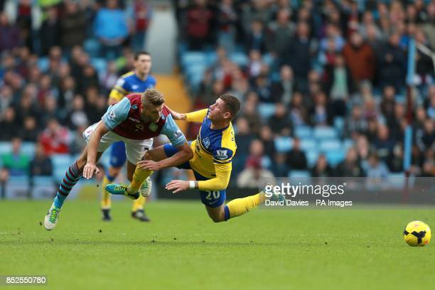 Everton's Ross Barkley and Aston Villa's Nathan Baker collide as they battle for the ball