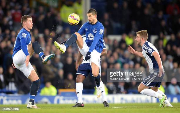 Everton's Ross Barkley and Kevin Mirallas battle for the ball with West Bromwich Albion's James Morrison