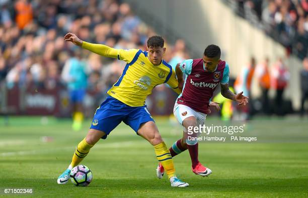 Everton's Ross Barkley and West Ham United's Manuel Lanzini battle for the ball during the Premier League match at London Stadium