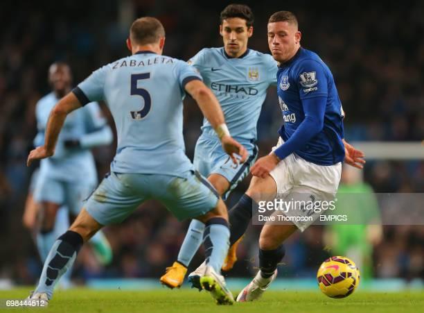 Everton's Ross Barkley takes on Manchester City's Pablo Zabaleta and Manchester City's Jesus Navas