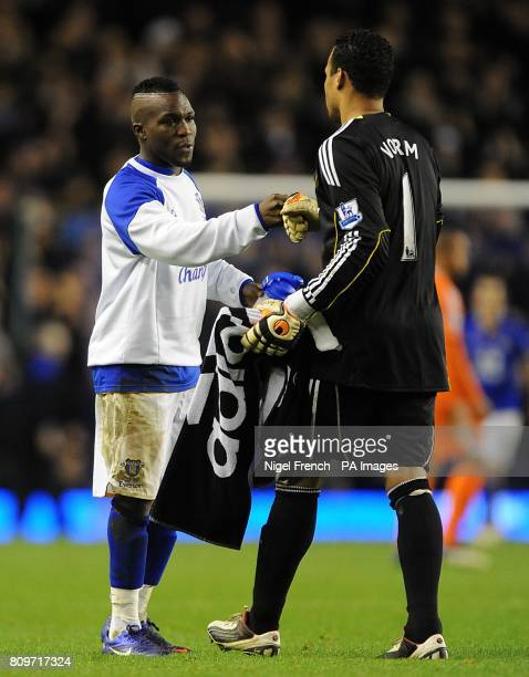 Everton's Royston Drenthe shakes ahands with Swansea City goalkeeper Michel Vorm after the final whistle