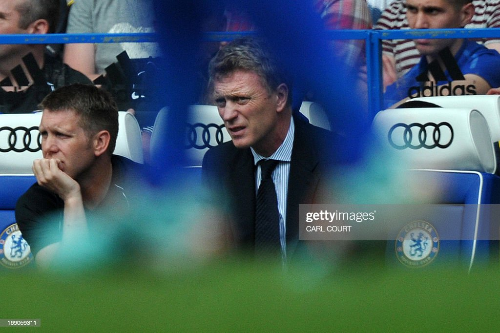 """Everton's Scottish manager David Moyes watches from the dugout during the English Premier League football match between Chelsea and Everton at Stamford Bridge in London on May 19, 2013, his last game in charge of Everton after agreeing to manage Manchester United from the end of this season. New Manchester United manager David Moyes will get the full backing of the club's senior players when he takes over from Alex Ferguson in the summer, veteran winger Ryan Giggs has said. USE. No use with unauthorized audio, video, data, fixture lists, club/league logos or """"live"""" services. Online in-match use limited to 45 images, no video emulation. No use in betting, games or single club/league/player publications."""