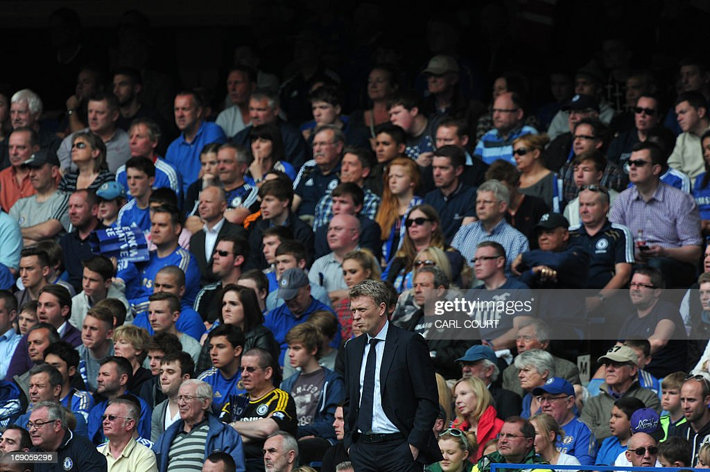 "Everton's Scottish manager David Moyes watches the action from the touchline during the English Premier League football match between Chelsea and Everton at Stamford Bridge in London on May 19, 2013. New Manchester United manager David Moyes will get the full backing of the club's senior players when he takes over from Alex Ferguson in the summer, veteran winger Ryan Giggs has said. USE. No use with unauthorized audio, video, data, fixture lists, club/league logos or ""live"" services. Online in-match use limited to 45 images, no video emulation. No use in betting, games or single club/league/player publications."