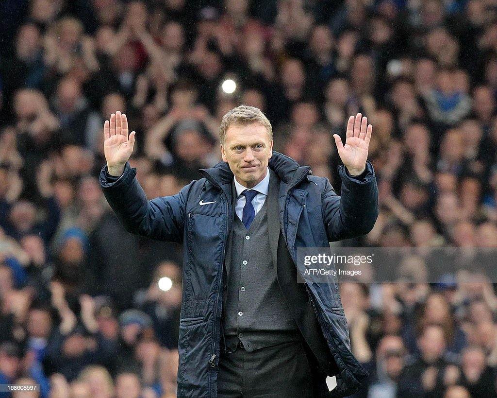 Everton's Scottish manager David Moyes waves to fans after their 2-0 win in the English Premier League football match between Everton and West Ham United at Goodison Park in Liverpool, north-west England, on May 12, 2013. David Moyes's final home match as Everton manager ended in a 2-0 Premier League victory over West Ham on Sunday thanks to two goals from Kevin Mirallas. Moyes, who will replace Alex Ferguson in charge of English champions Manchester United at the end of the season following the retirement of his fellow Scot, was applauded by all four stands before-kick off and had his name sung throughout by Everton fans in recognition of his 11 years as the Merseysiders' manager. AFP PHOTO / LINDSEY PARNABY USE. No use with unauthorized audio, video, data, fixture lists, club/league logos or live services. Online in-match use limited to 45 images, no video emulation. No use in betting, games or single club/league/player publications