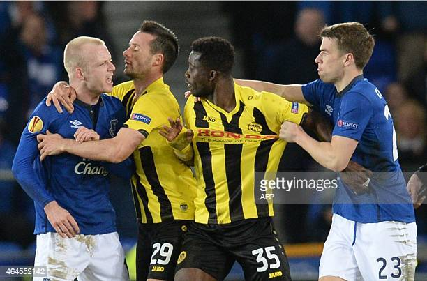 Everton's Scottish striker Steven Naismith and Young Boys' Ivorian midfielder Sekou Sanogo react during the UEFA Europa League round of 32 second leg...