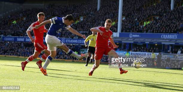 Everton's Seamas Coleman scores their first goal during the Barclays Premier League match at Goodison Park Liverpool