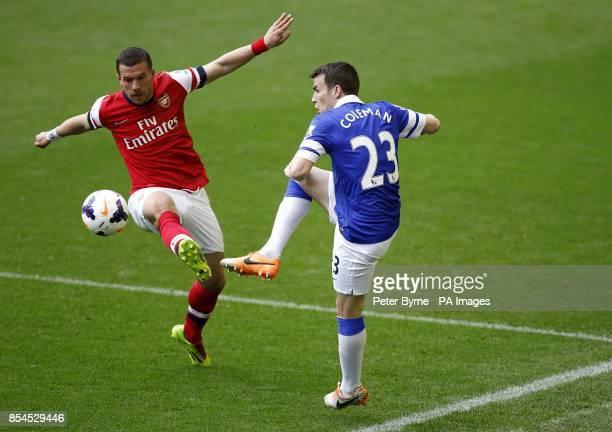 Everton's Seamus Coleman and Arsenal's Lukas Podolski battle for the ball