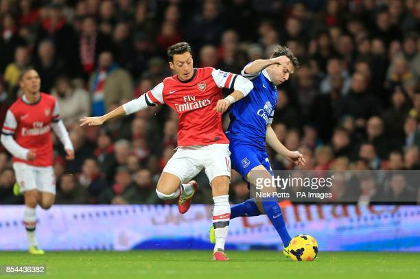 Everton's Seamus Coleman and Arsenal's Mesut Ozil battle for the ball